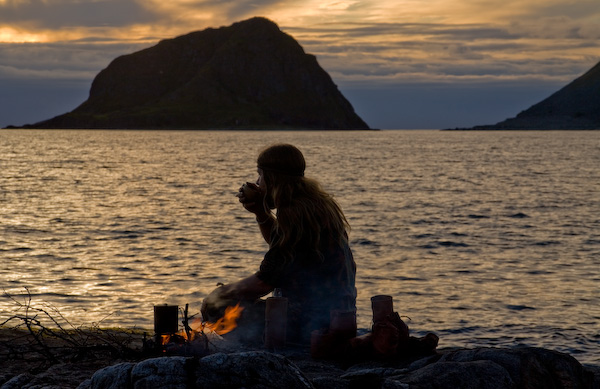 Sunset boil up by the sea. Bushcraft is about being relaxed in the wilderness.